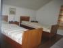 Schlafzimmer mit Einzelbetten in Asplia