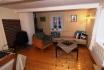 Havnnes Handelssted Borgerstua: Wohnzimmer mit Ofen