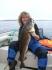 angelnde Frau mit chicem Dorsch