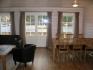 Efjord Sjøhus Ferienhaus 3: Essecke und Couch mit Fjordblick