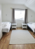 Schlafzimmer in Korsfjorden mit Einzelbetten