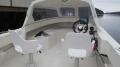 Orisbrygge: Angelboot mit Halbkajüte