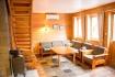 Senja Havfiske - living room with oven and varmepumpe