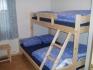 Vega Opplevelsesferie Ferienappartement EG: Schlafzimmer mit Familienstockbett